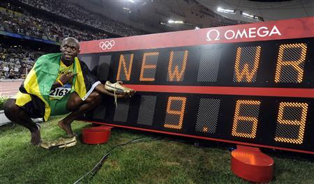 Usain Bolt of Jamaica celebrates winning the men's 100m final of the athletics competition in the National Stadium at the Beijing 2008 Olympic Games in this August 16, 2008 file photo. REUTERS/Kai Pfaffenbach