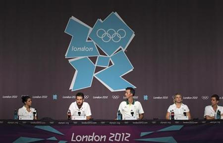 (L-R) Swimmers Stephanie Rice, James Magnusson, Leisel Jones and Eamon Sullivan and coach Nick Green (C) of the Australian Olympic swim team attend a news conference at the Media Press Centre in London 2012 Olympic Park in Stratford, east London July 23, 2012. REUTERS/Olivia Harris