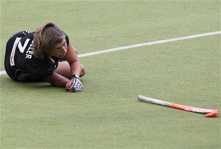 Natascha Keller of Germany lies on the ground during their final field hockey match against Netherlands at the women's EuroHockey Championships in Moenchengladbach August 27, 2011. REUTERS/Alex Domanski