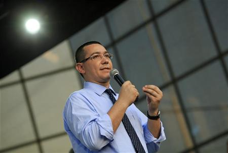 Leftist Prime Minister Victor Ponta, leader of the ruling Social Liberal Union, speaks during a rally promoting the impeachment of suspended President Traian Basescu in Craiova, 248 km (154 miles) west of Bucharest July 20, 2012. REUTERS/Radu Sigheti