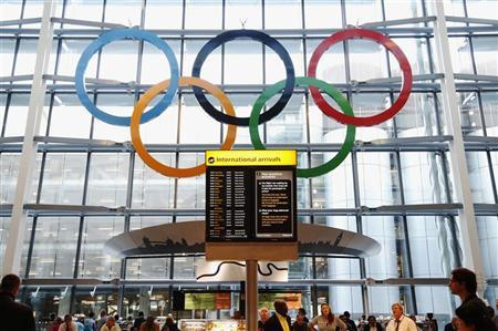 Olympic Rings are revealed during an unveiling ceremony in the Terminal Five arrivals hall at Heathrow Airport, June 20, 2012. REUTERS/Luke MacGregor