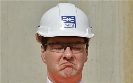 Britain's Chancellor of the Exchequer, George Osborne reacts during a tour of a Crossrail construction site in central London July 18, 2012. REUTERS/Toby Melville