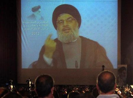 Lebanon's Hezbollah leader Sayyed Hassan Nasrallah addresses his supporters via a video projection during a ceremony marking the 23rd anniversary of the death of the founder of the Islamic Republic Ayatollah Ruhollah Khomeini, in Beirut in this June 1, 2012 file photo. REUTERS/Sharif Karim