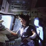 Astronaut Sally Ride, mission specialist on STS-7, monitors control panels from the pilot's chair on the Flight Deck of the Space Shuttle Challenger in this NASA handout photo dated June 25, 1983. Floating in front of her is a flight procedures notebook. Ride died July 23, 2012 after a 17-month battle with pancreatic cancer. REUTERS/NASA/Handout