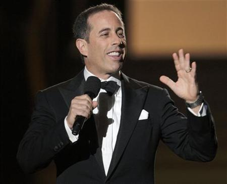 Comedian Jerry Seinfeld speaks during the taping of ''Oprah's Surprise Spectacular'' in Chicago May 17, 2011. REUTERS/John Gress