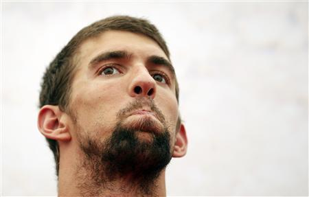 Michael Phelps of the U.S. swimming team reacts during a promotional event in London July 25, 2012. REUTERS/Damir Sagolj