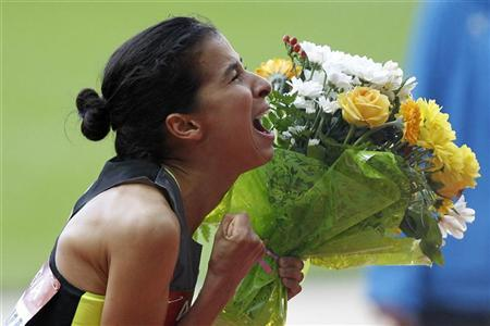 Mariem Alaoui Selsouli of Morocco celebrates after winning the women's 1,500 metres at the IAAF Diamond League athletics meeting at the Stade de France Stadium in Saint-Denis, near Paris July 6, 2012. REUTERS/Gonzalo Fuentes