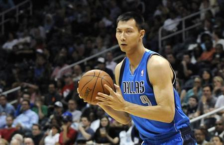 Dallas Mavericks forward Yi Jianlian of China plays in the second half of their NBA basketball game against the Atlanta Hawks in Atlanta, Georgia April 26, 2012. REUTERS/Tami Chappell