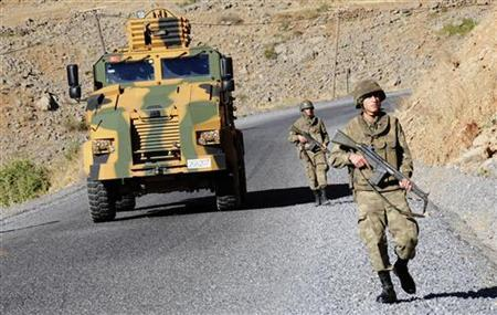 Turkish soldiers patrol a road near Cukurca in the Hakkari province, southeastern Turkey, near the Turkish-Iraqi border October 22, 2011. REUTERS/Stringer