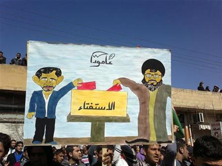 Demonstrators hold a banner showing Lebanon's Hezbollah leader Sayyed Hassan Nasrallah (R) and Syria's President Bashar Al-Assad voting, during a protest against voting for a referendum on a new constitution in Amude February 26, 2012. REUTER/Handout