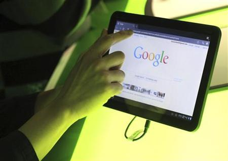 The Google home page is shown on Google's Android operating system, Honeycomb, on a Motorola Xoom tablet device following a news conference at Google Headquarters in Mountain View, California February 2, 2011. REUTERS/Beck Diefenbach/Files
