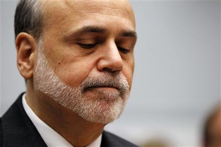 U.S. Federal Reserve Chairman Ben Bernanke reacts as he testifies before the House Committee on the Financial Services semi-annual monetary policy report on Capitol Hill in Washington, in this July 18, 2012 file photo. REUTERS/Jason Reed/Files
