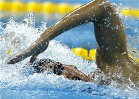 Ranomi Kromowidjojo of the Netherlands competes in the women's 100m freestyle heats at the 14th FINA World Championships in Shanghai July 28, 2011. REUTERS/David Gray