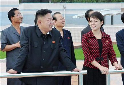 North Korean leader Kim Jong-Un (2nd L) and an unidentified woman visit the Rungna People's Pleasure Ground, which is nearing completion, in Pyongyang in this undated picture released by the North's KCNA on July 25, 2012. REUTERS/KCNA