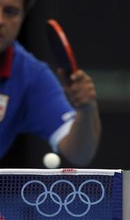 An unidentified player practices table tennis in the ExCel venue during a practice session before the start of the London 2012 Olympic Games in London July 25, 2012. REUTERS/Kim Kyung-Hoon