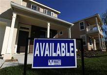 A newly constructed home available for sale is pictured in a new housing development area in Vista, California in this file photo taken March 20, 2012. New U.S. home sales recorded their biggest drop in more than a year in June and prices resumed their downward trend, dealing a setback for the budding housing market recovery. Single family home sales tumbled 8.4 percent to a seasonally adjusted 350,000-unit annual rate, the lowest rate in five months, the Commerce Department said on Wednesday. REUTERS/Mike Blake/Files