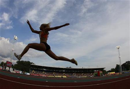 Paraskevi Papachristou of Greece competes in the women's triple jump during the London Grand Prix, Diamond League, athletics meeting at Crystal Palace in London August 5, 2011. REUTERS/Stefan Wermuth