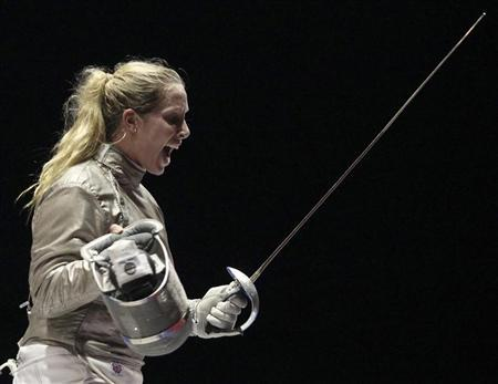 Mariel Zagunis of the U.S. celebrates after winning the women's individual sabre final event Alejandra Benitez of Venezuela at the Pan American Games in Guadalajara October 25, 2011. REUTERS/Sergio Moraes