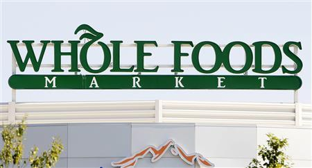 The sign for the Whole Foods grocery store is seen in Lakewood, Colorado in this September 11, 2007, file photo. The upscale grocery chain reported quarterly profit that topped Wall Street's view after sales at established stores defied the softening U.S. Economy, sending the shares surging 11 percent in an after-hours relief rally. REUTERS/Rick Wilking/Files