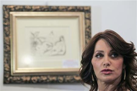 Former Romanian Olympic gold medal gymnast Nadia Comaneci looks on before a charity auction organised in the benefit of her foundation in Bucharest June 22, 2011. REUTERS/Radu Sigheti
