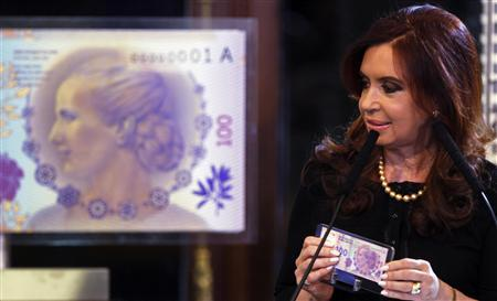 Argentina's President Cristina Fernandez de Kirchner speaks as she presents the new 100 pesos bank note with a portrait of former First Lady Eva Peron to commemorate Thursday's 60th anniversary of Eva's death, during a ceremony at the Casa Rosada Presidential Palace in Buenos Aires July 25, 2012. REUTERS/Marcos Brindicci