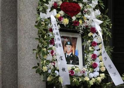 A portrait of U.S. Army Private Danny Chen is displayed during his funeral procession in New York October 13, 2011. REUTERS/Brendan McDermid