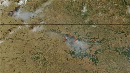 A smoke plume from the Fairfield Creek fire in Nebraska - along the Niobrara River east of Valentine - is pictured in this July 22, 2012 NASA handout satellite image obtained by Reuters July 24, 2012. REUTERS/NASA/Handout