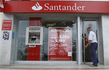 A man walks into a Santander's bank office in El Masnou, near Barcelona, June 11, 2012. REUTERS/Albert Gea