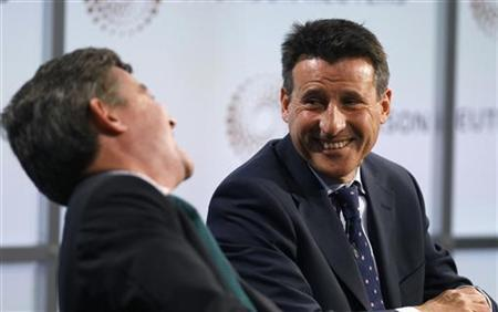 Britain's Minister for Sport, Hugh Robertson, and Sebastian Coe (R), chairman of the London organising committee of the Olympic Games (LOCOG), answer questions during a Reuters Newsmaker event at the offices of Thomson Reuters in the Canary Wharf district of London July 21, 2011. REUTERS/Andrew Winning
