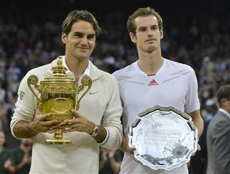 Roger Federer of Switzerland (L) holds his winners trophy and Andy Murray of Britain holds his runners-up trophy after Federer defeated Murray in their men's singles final tennis match at the Wimbledon Tennis Championships in London July 8, 2012. REUTERS/Toby Melville