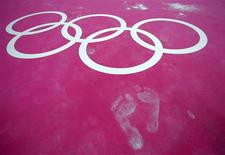Footprints are seen on the floor during a gymnastics training session at the O2 Arena before the start of the London 2012 Olympic Games July 26, 2012. REUTERS/Brian Snyder
