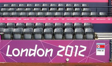 Empty seats are seen in the stands ahead of the women's Group G football match between North Korea and Colombia at the London 2012 Olympic Games in Hampden Park, Glasgow, Scotland July 25, 2012. REUTERS/David Moir