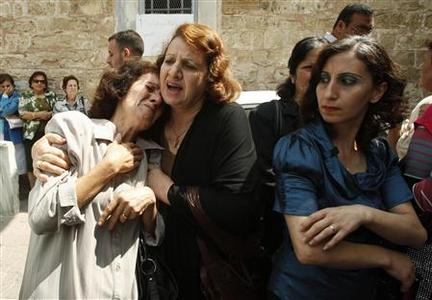 Palestinian Christians react during a protest in front of the Saint Porfirios church in Gaza City, against what they say is a forced conversion to Islam July 22, 2012. REUTERS/Ahmed Zakot