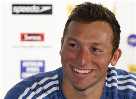 Australia's Ian Thorpe smiles while speaking at a news conference after the semi-finals of the men's 100m Freestyle at the 2012 Australian Swimming Championships, after failing to qualify for the 2012 London Olympics, in Adelaide March 18, 2012. REUTERS/Regi Varghese