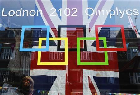 A woman looks at a shop display, which pokes fun at the London 2012 Olympics licensing rules, in south London July 26, 2012. REUTERS/Olivia Harris