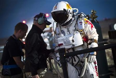 Pilot Felix Baumgartner of Austria walks to the capsule on the flight line during the second manned test flight for Red Bull Stratos in Roswell, New Mexico July 25, 2012. REUTERS/Predrag Vuckovic/Red Bull Content Pool /handout