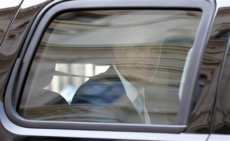 U.S. Republican Presidential candidate Mitt Romney looks out from a vehicle after meetings with British Prime Minister David Cameron and British Chancellor of the Exchequer George Osborne at 10 Downing Street in London, July 26, 2012. REUTERS/Jason Reed