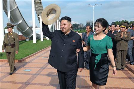 North Korean leader Kim Jong-Un and his wife Ri Sol-Ju attend the opening ceremony of the Rungna People's Pleasure Ground on Rungna Islet along the Taedong River in Pyongyang in this July 25, 2012 photograph released by the North's KCNA to Reuters on July 26, 2012. REUTERS/KCNA