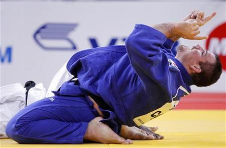 Andreas Toelzer of Germany celebrates winning his over 100kg men's semi-final bout against Oscar Brayson of Cuba at the World Judo Championships in Paris August 27, 2011. REUTERS/Yves Herman