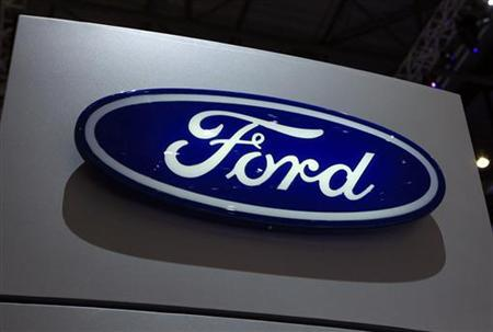 A Ford logo is seen on the car maker's booth during the first media day of the Geneva Auto Show at the Palexpo in Geneva, March 6, 2012. The Geneva Auto Show will take place from March 8 to 18, 2012. REUTERS/Denis Balibouse