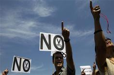 "Civil servants hold ""No to cuts"" placards as they take part in a protest against government austerity measures outside Madrid's town hall July 25, 2012. REUTERS/Susana Vera"