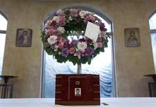 The urn containing the ashes of Jun Lin sits in a funeral home prior to the funeral services in Montreal, July 26, 2012. REUTERS/Christinne Muschi