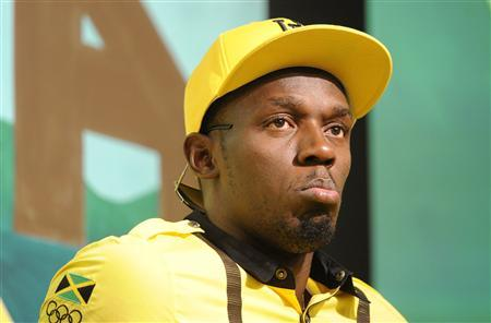 Jamaican sprinter Usain Bolt looks on during a team news conference in east London, July 26, 2012. REUTERS/Paul Hackett