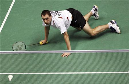 Misha Zilberman of Israel falls as he plays against Dicky Palyama of the Netherlands in their men's singles match at the 2010 Badminton World Championships at the Coubertin stadium in Paris August 25, 2010. REUTERS/Regis Duvignau