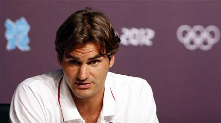 Swiss tennis player Roger Federer answers a reporter's question during a news conference in the Olympic media centre before the start of the London 2012 Olympic Games July 26, 2012. REUTERS/Sergio Perez