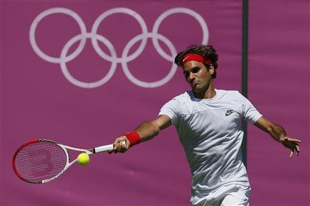 Switzerland's Roger Federer returns the ball during a training session at the All England Lawn Tennis Club before the start of the London 2012 Olympic Games in London July 23, 2012. REUTERS/Stefan Wermuth