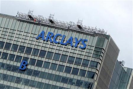 The letter ''B'' of the signage on the Barclays headquarters in Canary Wharf is hoisted up the side of the building in London July 20, 2012. REUTERS/Simon Newman
