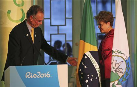 Brazil's President Dilma Rousseff (R) and Carlos Arthur Nuzman, president of the Brazilian Olympic Committee preside over the inauguration of the Casa Brasil (Brazil House), headquarters for Brazil's campaign to promote the Rio 2016 Olympic Games, in London July 26, 2012. REUTERS/Sergio Moraes