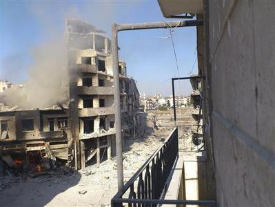 A building burns after shelling at Juret al-Shayah in Homs city July 25, 2012. Picture taken July 25, 2012. REUTERS/Shaam News Network/Handout