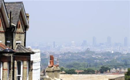 Buildings in the centre of the city are obscured in a haze, as seen from Crystal Palace in south London June 26, 2010. REUTERS/Paul Hackett